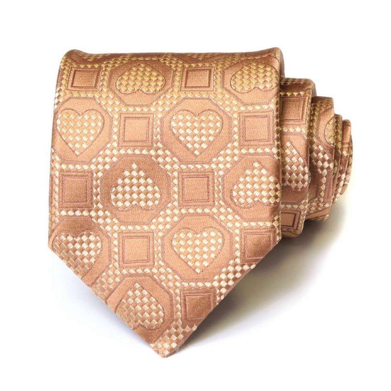 Бежевый шелковый галстук Moschino c сердечками