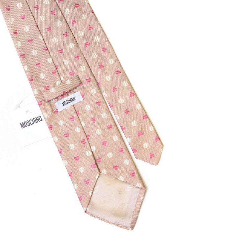 Бежевый шелковый галстук Moschino c розовыми сердечками