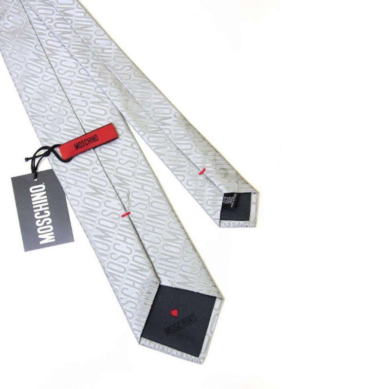 Серебристый шелковый галстук Moschino c логотипом