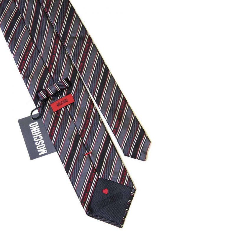 Серый в полоску шёлковый галстук с надписями Moschino