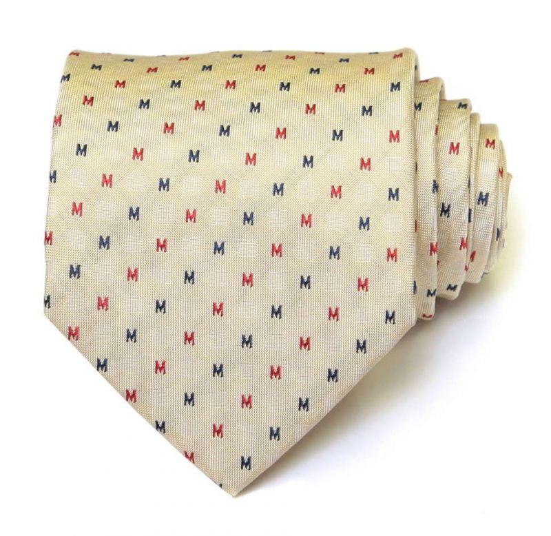 Бежевый шёлковый галстук Moschino с буквами