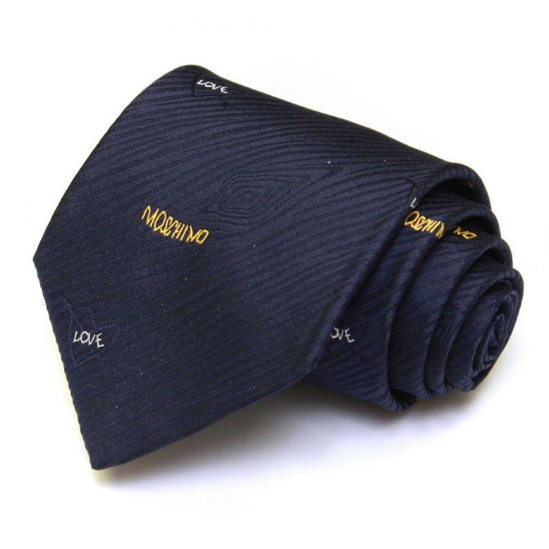 Тёмно-синий шёлковый галстук Moschino с выделкой, с надписями