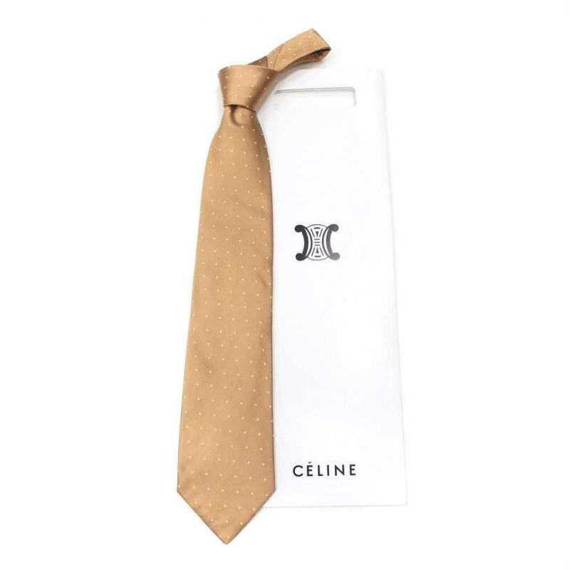 Бежевый шёлковый галстук Celine в жёлтый горох