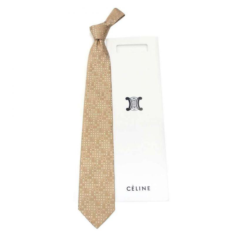 Золотистый шёлковый галстук Celine с мелким рисунком