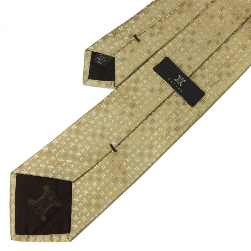 Бежевый шёлковый галстук Celine с мелким рисунком