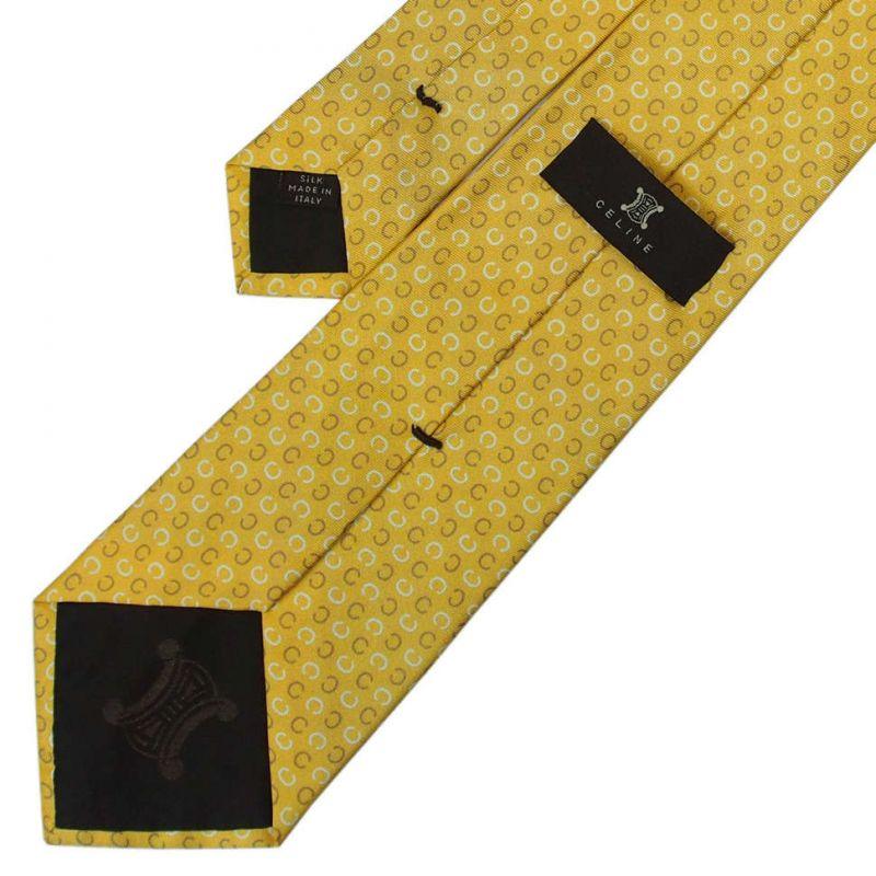 Жёлто-золотой шелковый галстук со значками Celine