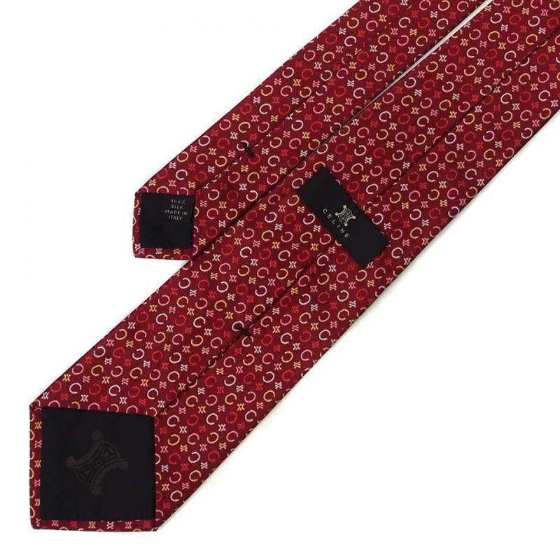 Бордовый шелковый галстук Celine со знаками