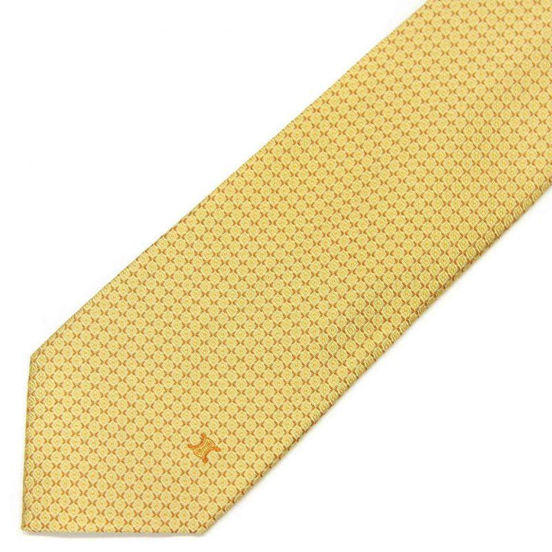 Жёлтый шёлковый галстук Celine с мелким рисунком