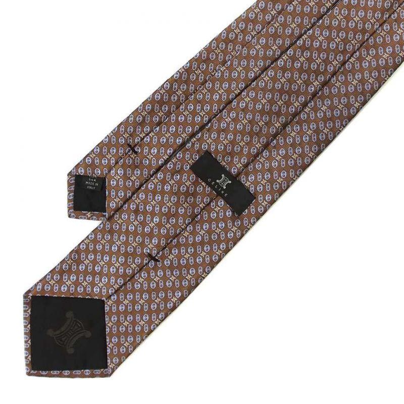 Коричневый шёлковый галстук Celine с голубым рисунком