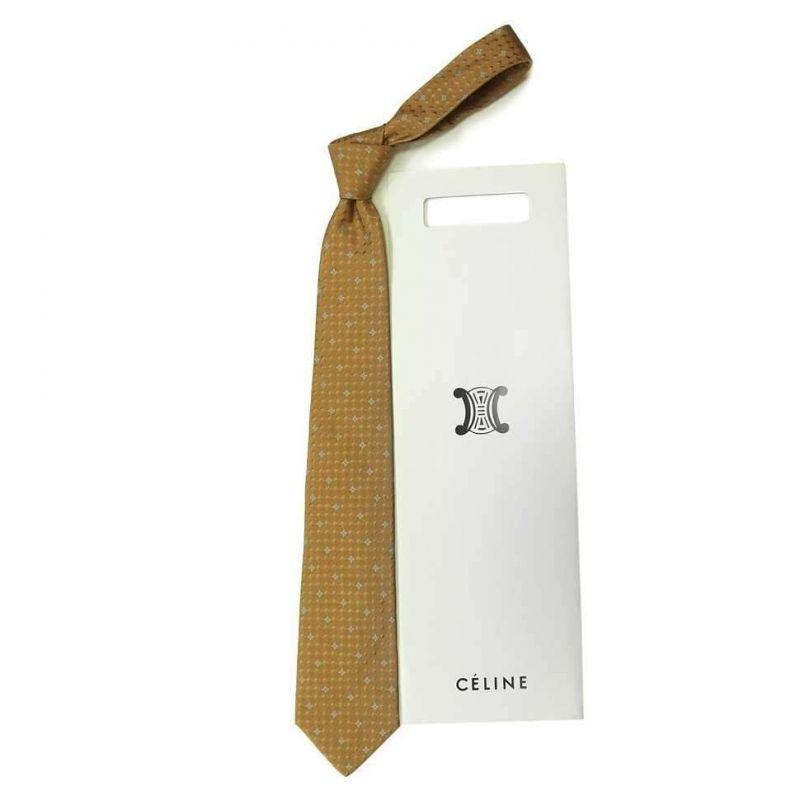 Горчичный шёлковый галстук Celine с мелким рисунком