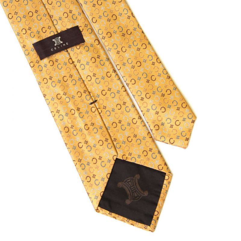 Жёлтый шёлковый галстук с символикой бренда Celine