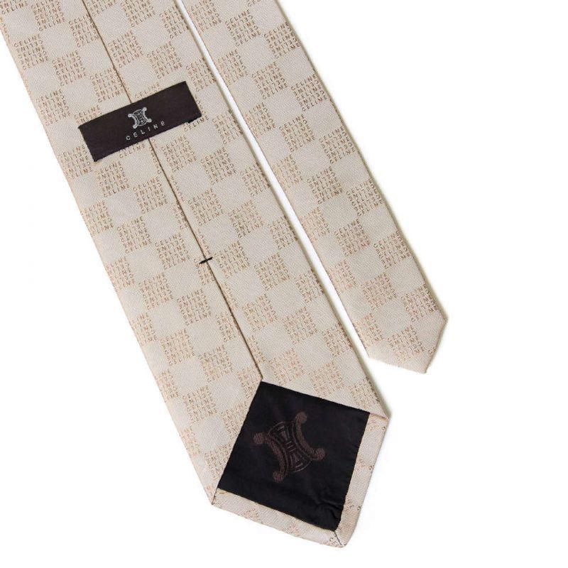 Бежевый шёлковый галстук Celine с выделкой