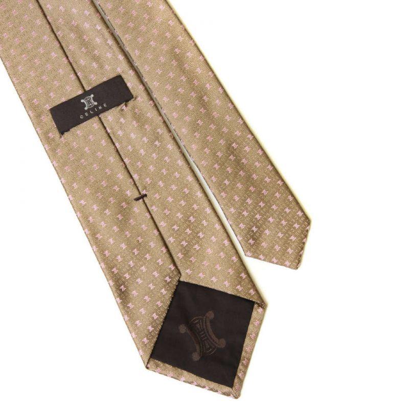 Золотистый шёлковый галстук с розовыми лого Celine