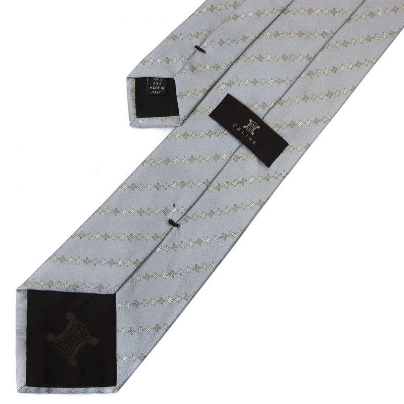 Серый шёлковый галстук Celine в полоску из логотипов