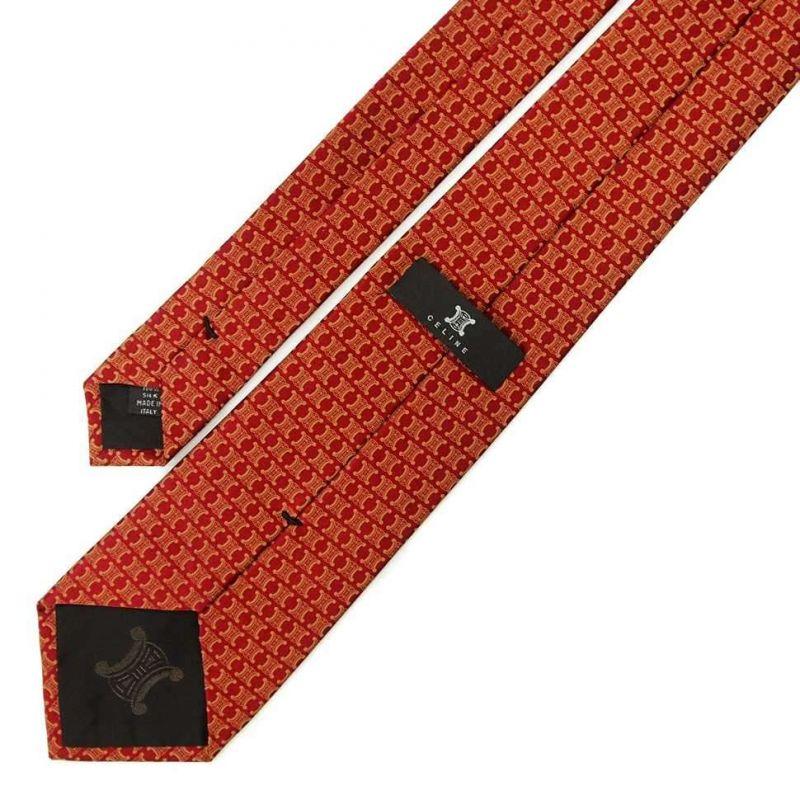 Бордовый шёлковый галстук с золотистыми логотипами Celine