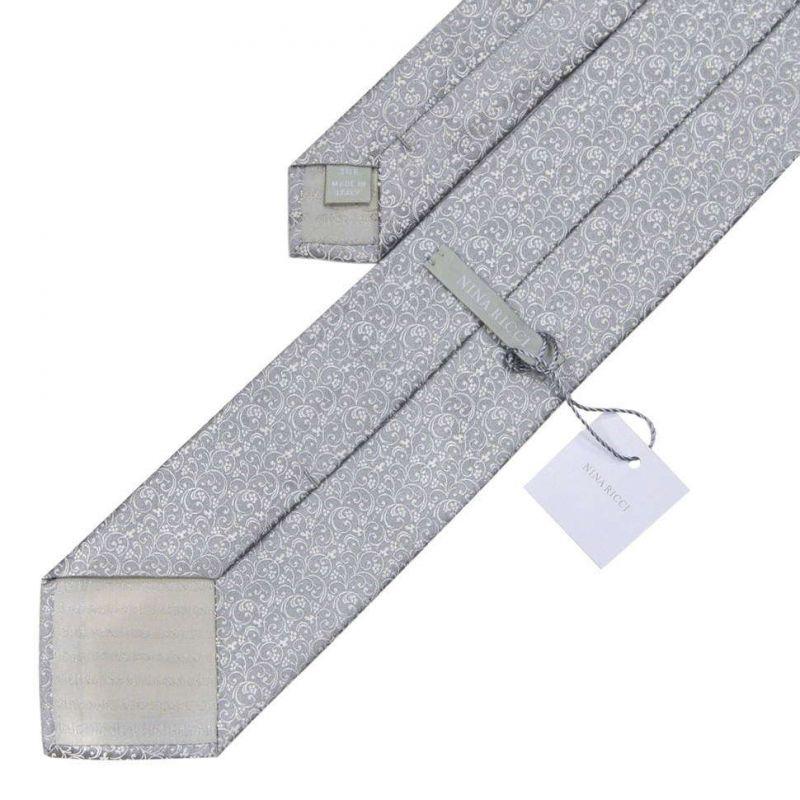 Серебристый галстук Nina Ricci с витиеватым рисунком